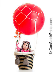 child with pilot hat on hot air balloon