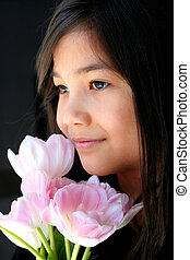 Child with pink tulips