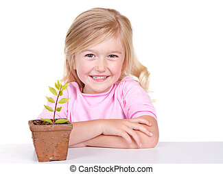 child with plant smiling