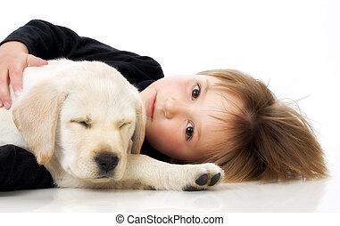 Child with puppy - Child with Labrador retriever puppy