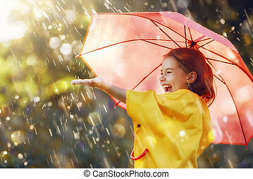 child with red umbrella - Happy funny child with red...