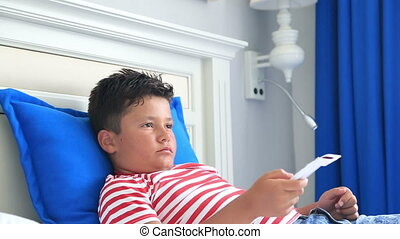 Child with remote controller