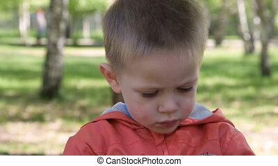 Child with retro camera in the park