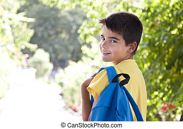 child with school bag outdoors