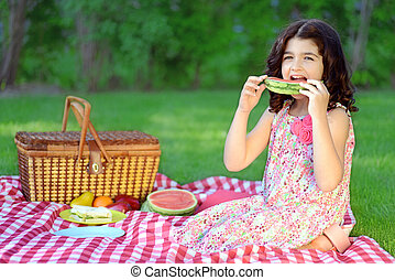 child with slice watermelon