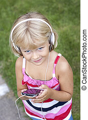 Child with smartphone and headphones