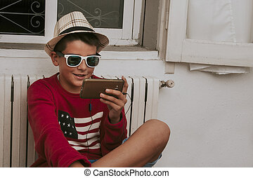 child with smartphone at home