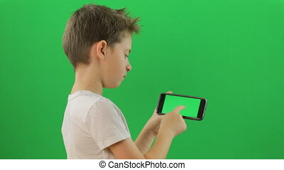 Child with smartphone device, Green Screen