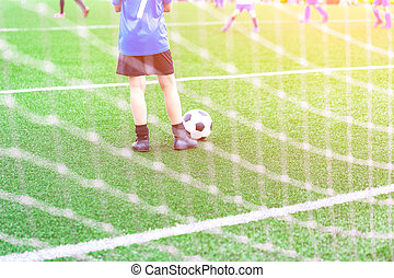 Child with Soccer ball at football grounds