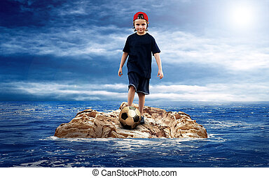 Child with soccerball on the island in sea.