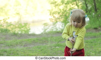 Child with stick picnic