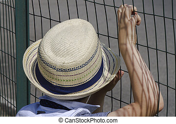 child with straw hat