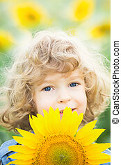 Child with sunflower