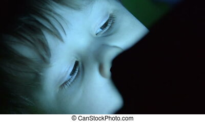 Child with tablet PC at night
