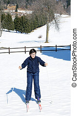 child with the cross-country skiing in the mountains