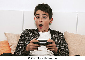 child with the remote control of the video game console playing celebrating the success