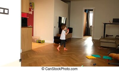 Child with toy entering living room - Full body little kid ...