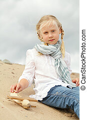 Child with toy outdoors