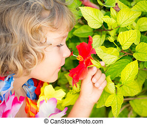 Child with tropic flower - Happy child with tropic flower. ...