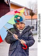 child with umbrella, symbol of childhood, solidarity, help,...