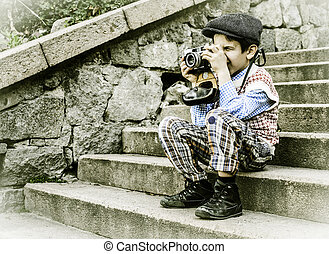 Child with vintage camera