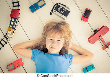 Girl power - Child with vintage toys at home. Girl power and...