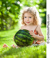 Child with watermelon