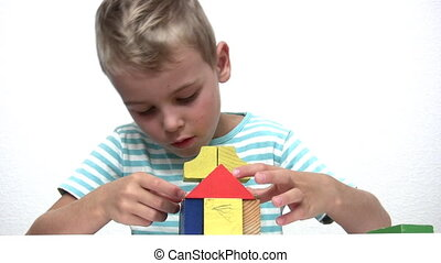 child with wood toy cubes