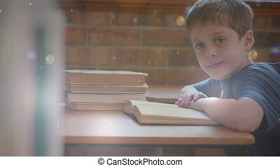Child working in the classroom surrounded by animation of bokeh effect