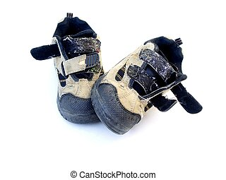 childs worn out shoes isolated