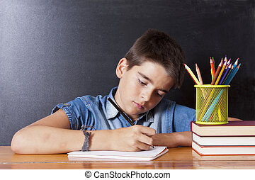child writing in the school table