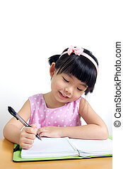 Child writing - Little kid is doing her home work with...