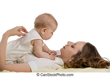 Childcare. Photo of mother plays with her baby