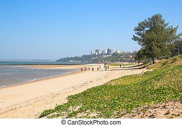 Childern playing football on the beach of Maputo