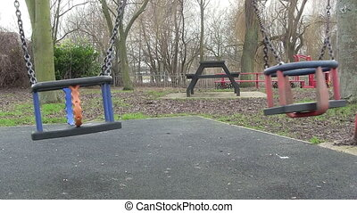 Childes swing in a play ground.