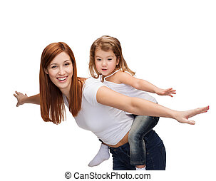 childhood and parenting concept - happy mother and child doing piggy back