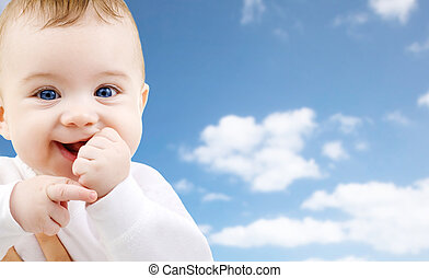 close up of sweet little baby over sky background - ...