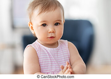 portrait of little baby girl at home