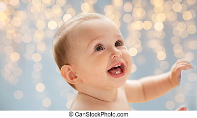 happy little baby boy or girl looking up