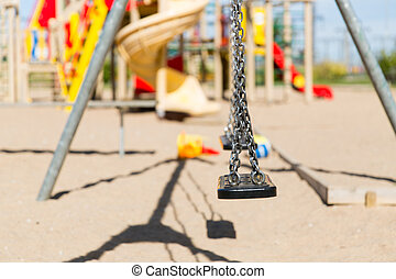 close up of swing on playground outdoors