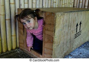 Childhood Games - Hide and Seek - A little girl plays hide ...