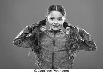 childhood happiness. Family. Kid fashion and sportswear. Happy little girl with long hair. childrens day. Portrait of happy little child. Small girl child. Hairdresser for kids. Little treasure