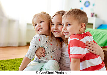 happy little kids hugging at home
