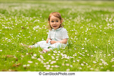 happy little baby girl at park in summer