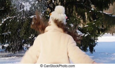 happy little girl throwing snow in winter park - childhood, ...