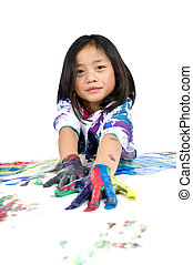 Childhood Painting - A young asian girl having fun painting...