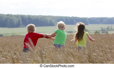 Childhood rivalry - Children trying to outrun each other in...
