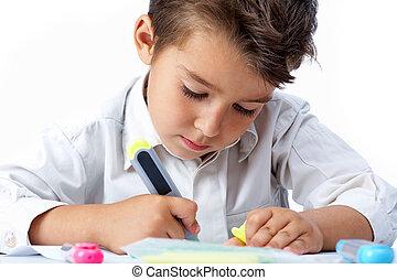 Childish hobby - Portrait of school boy drawing something...
