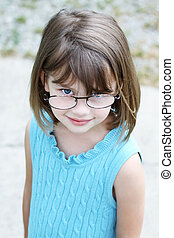 Childl wearing glasses