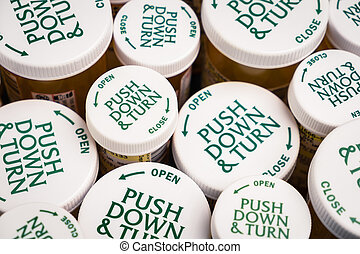 Childproof Tops of Prescription Bottles - Childproof tops of...